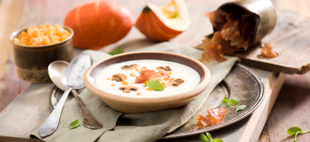 Cauliflower cream soup with baked pumpkin and dried ham